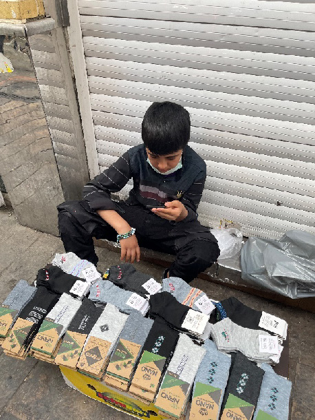 IRAN | AUG. 16, 2021 — Boy Selling Socks Receives SD Card with Christian Literature